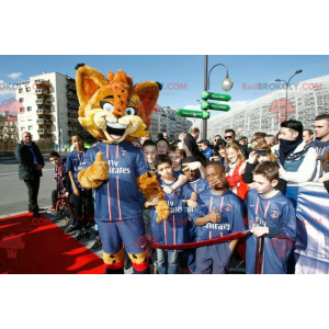 Oranje lynx mascotte met blauwe ogen - Redbrokoly.com