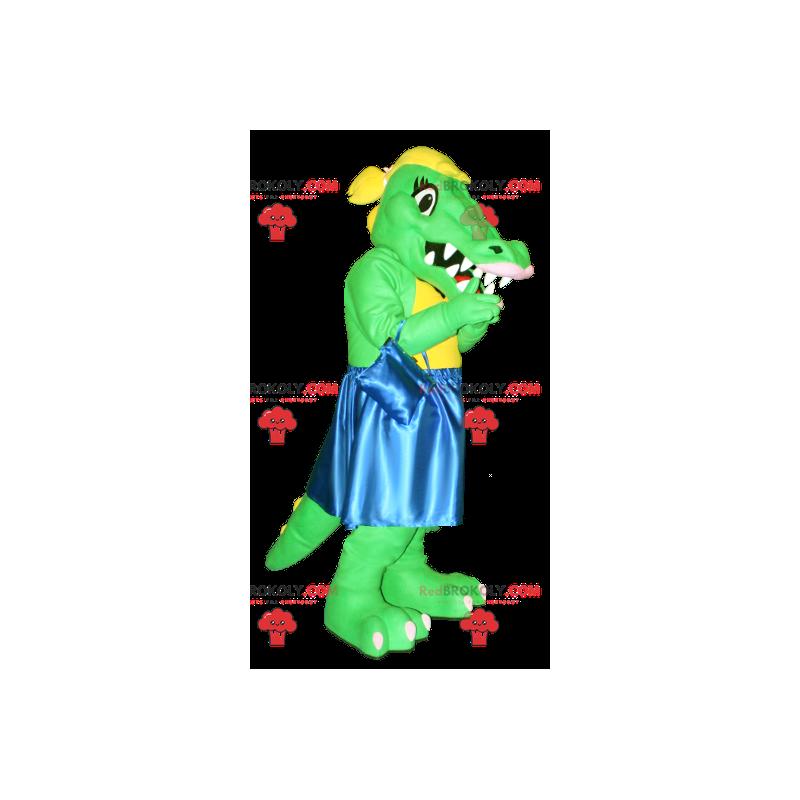 Grünes und gelbes Krokodilmaskottchen mit einem blauen Kleid -