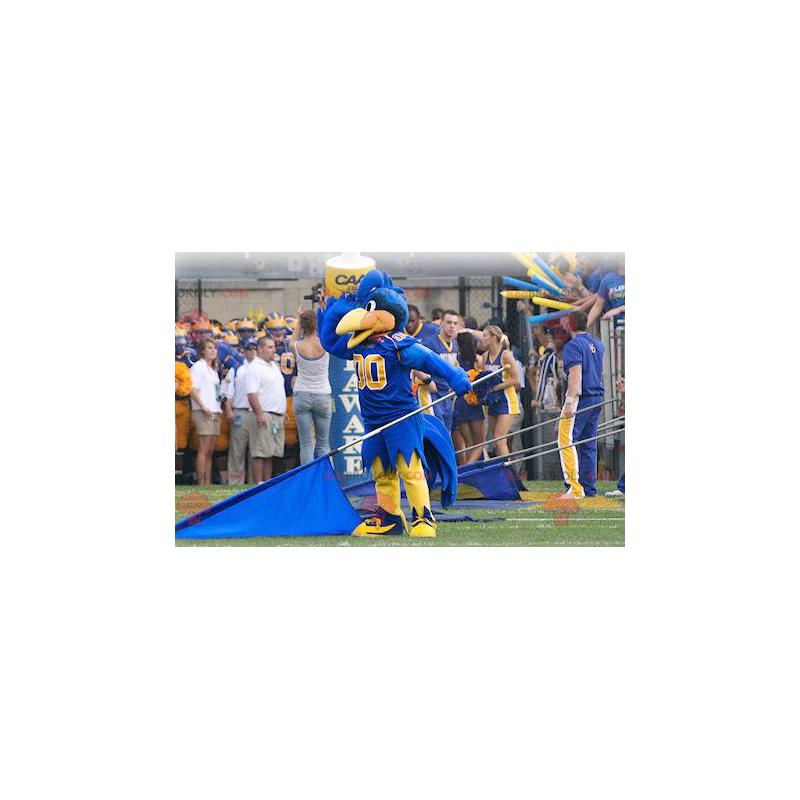 Blaues und gelbes Vogelmaskottchen in der Sportbekleidung -