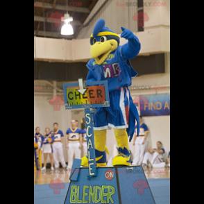 Modré a žluté ptačí maskot ve sportovním oblečení -