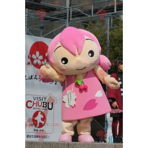 Mädchen Maskottchen mit Haaren und einem rosa Kleid -