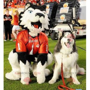 Maskot bílý a černý pes s modrýma očima - Redbrokoly.com