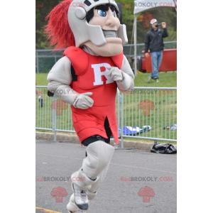 Cavaleiro mascote usando armadura vermelha e cinza -