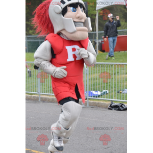 Knight mascot wearing red and gray armor - Redbrokoly.com