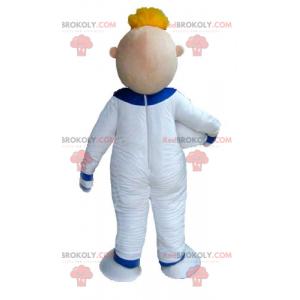 Astronautenmaskottchen des blonden Mannes im weißen Overall -