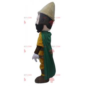 Cavaleiro mascote com uma roupa amarela e uma capa verde -