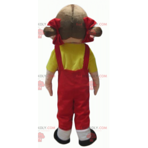 Mascot girl in red overalls with a yellow t-shirt -