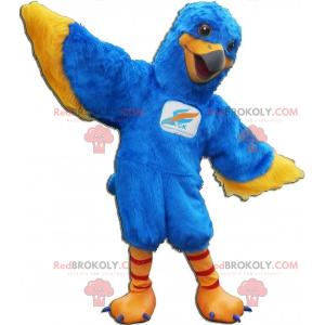 Blaues und gelbes Vogelmaskottchen. Adler Maskottchen -