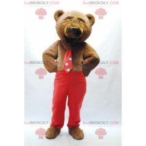 Maskot medvěd hnědý s kravatou a červené kalhoty -
