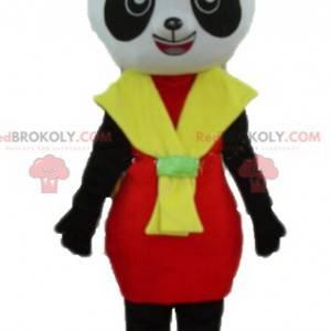 Czarno-biała maskotka panda z czerwono-żółtą sukienką -