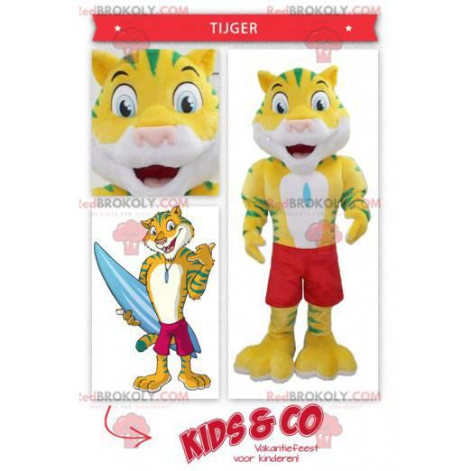 Gelbes und grünes Tigermaskottchen mit Badeshorts -