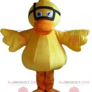 Gelbes und orange Entenkükenmaskottchen mit einer Maske -