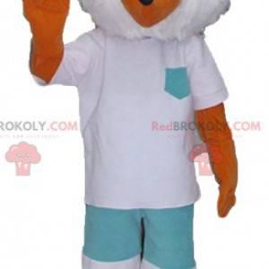 Pomarańczowo-biała maskotka lis w biało-zielonym stroju -
