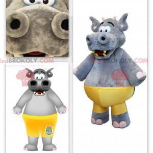 Grote grijze nijlpaard mascotte met een gele trui -