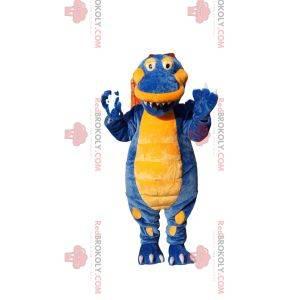 Mascote de dinossauro super feliz azul e amarelo
