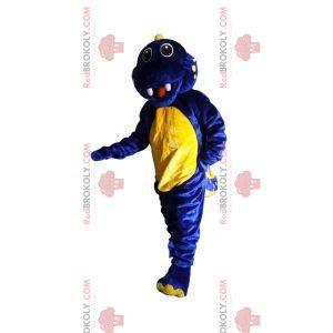 Super podekscytowana niebiesko-żółta maskotka dinozaura