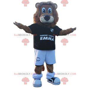 Maskot lva s černým fotbalovým oblečením