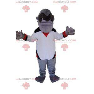Mascot mono gris con una camiseta blanca. Disfraz de mono