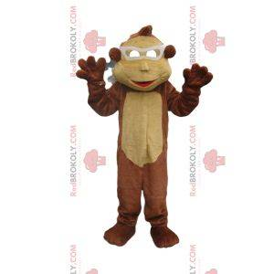 Braunes und beige Affenmaskottchen mit weißer Brille