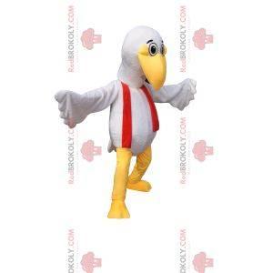 Maskot bílého ptáka s legrační zobákem a červeným šátkem