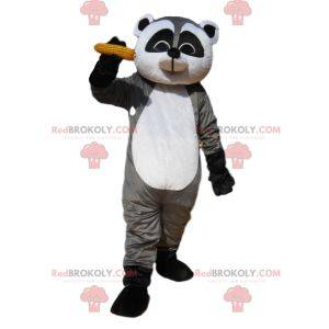Grijze en zwarte wasbeer mascotte met een korenaar