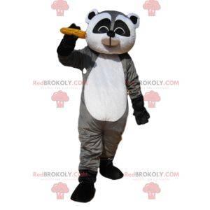 Mascot mapache gris y negro con una mazorca de maíz