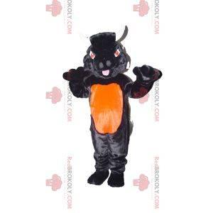 Mascota de toro negro y naranja con ojos rojos