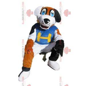 Tricolor dog mascot with a blue supporter jersey