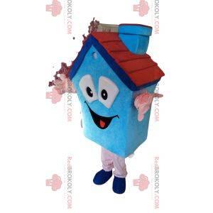 Blaues Hausmaskottchen mit einem kleinen Kamin