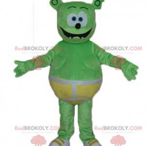 Green monster teddy mascot with yellow underpants -