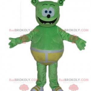 Maskot zelené plyšové monstrum se žlutými spodky -