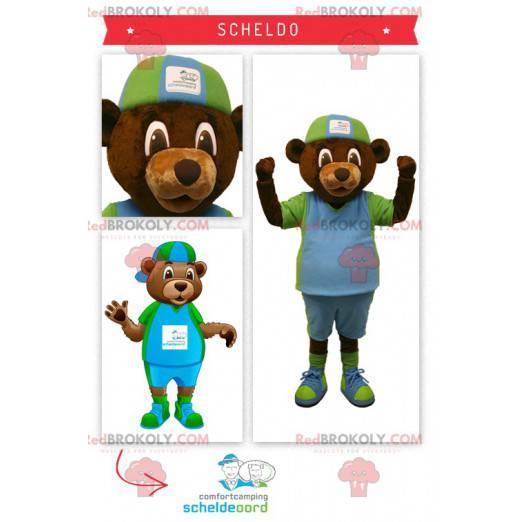 Braunbärenmaskottchen im grünen und blauen Outfit -