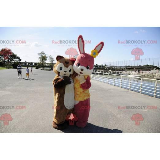 Rosa Kaninchenmaskottchen und braunes Meerschweinchen -