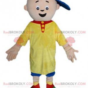 Kleines Jungenmaskottchen im gelben und blauen Outfit -