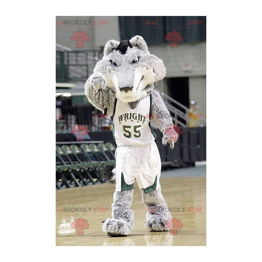 Graues und weißes Wolfsmaskottchen im Basketballoutfit -