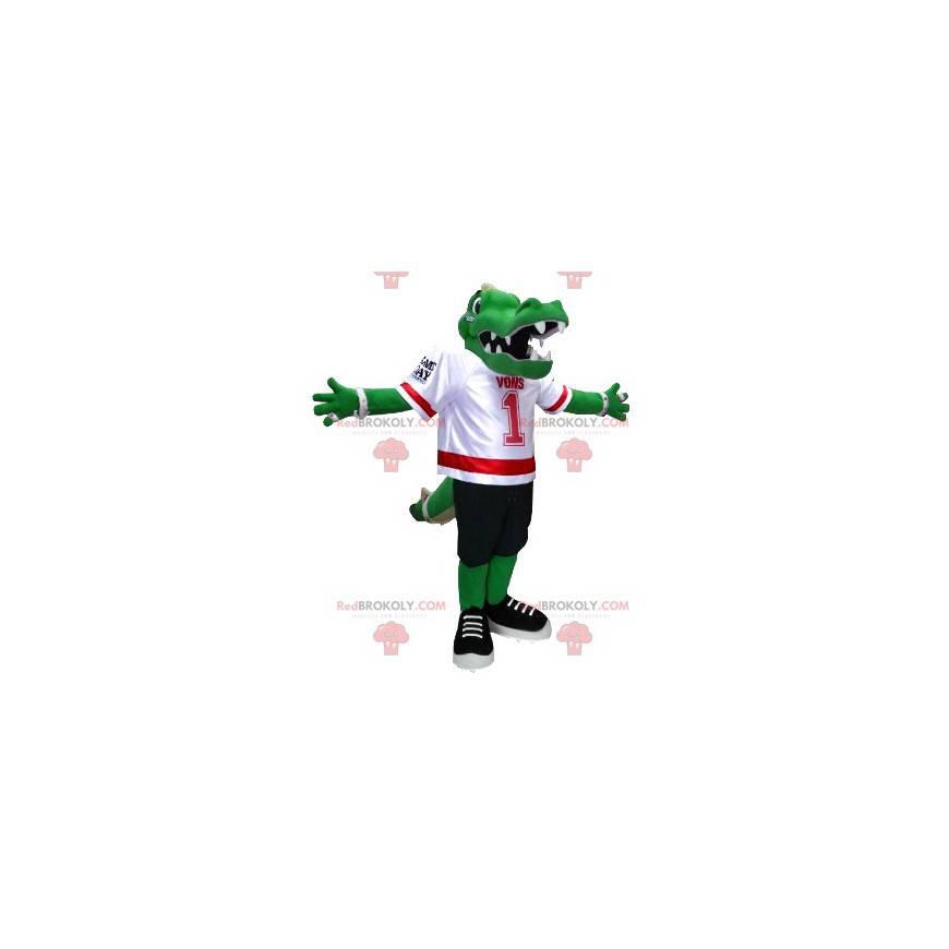 Grünes Krokodilmaskottchen in American-Football-Ausrüstung -