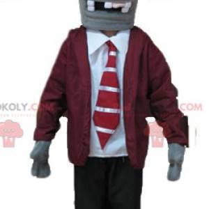 Untotes Skelettmaskottchen in Anzug und Krawatte -