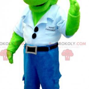 Zielona maskotka dinozaura w dżinsach z niebieską koszulą -
