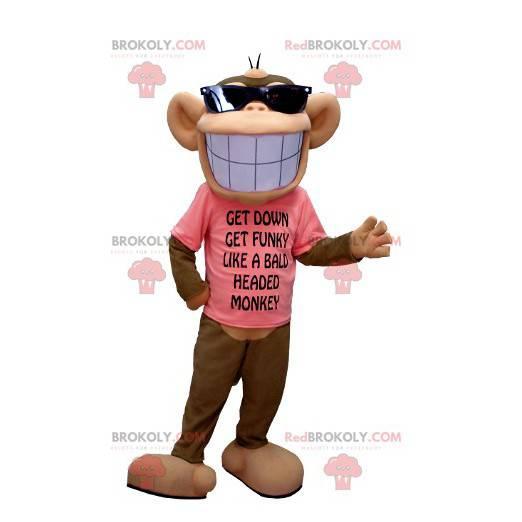 Braunes und beige Affenmaskottchen mit einem breiten Lächeln -