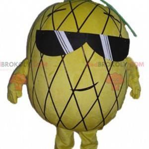 Gelbes und grünes Ananasmaskottchen mit Sonnenbrille -