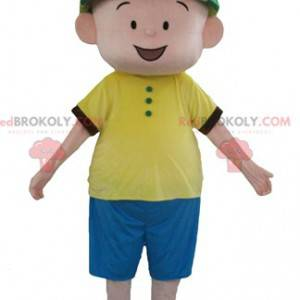 Boy mascot in blue and yellow outfit with a green hat -