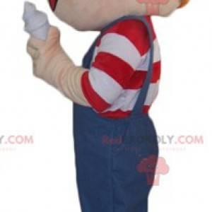 Maskottchen rothaariger Junge in Overalls mit einem Eis -