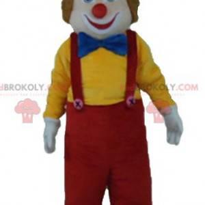 Mehrfarbiges lächelndes und niedliches Clownmaskottchen -