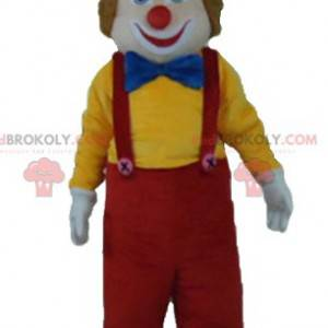 Veelkleurige lachende en schattige clown mascotte -