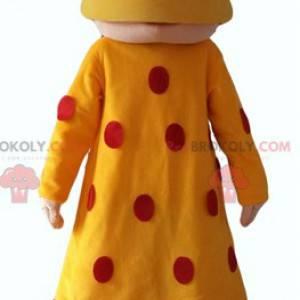 Mascote oriental com um vestido amarelo com bolinhas vermelhas