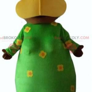 Afrikaanse vrouw mascotte met een groene bloemenjurk -