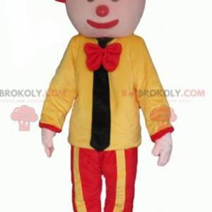 Gelbes und rotes Clownmaskottchen mit einer Krawatte -