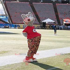 Gray wolf mascot with floral pants and a red t-shirt -