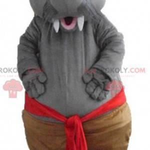 Mascotte di foca di tricheco grigio con grandi denti -