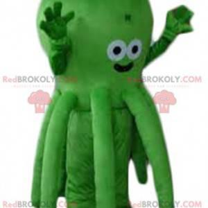 Sehr süßes und lächelndes grünes Oktopusmaskottchen -